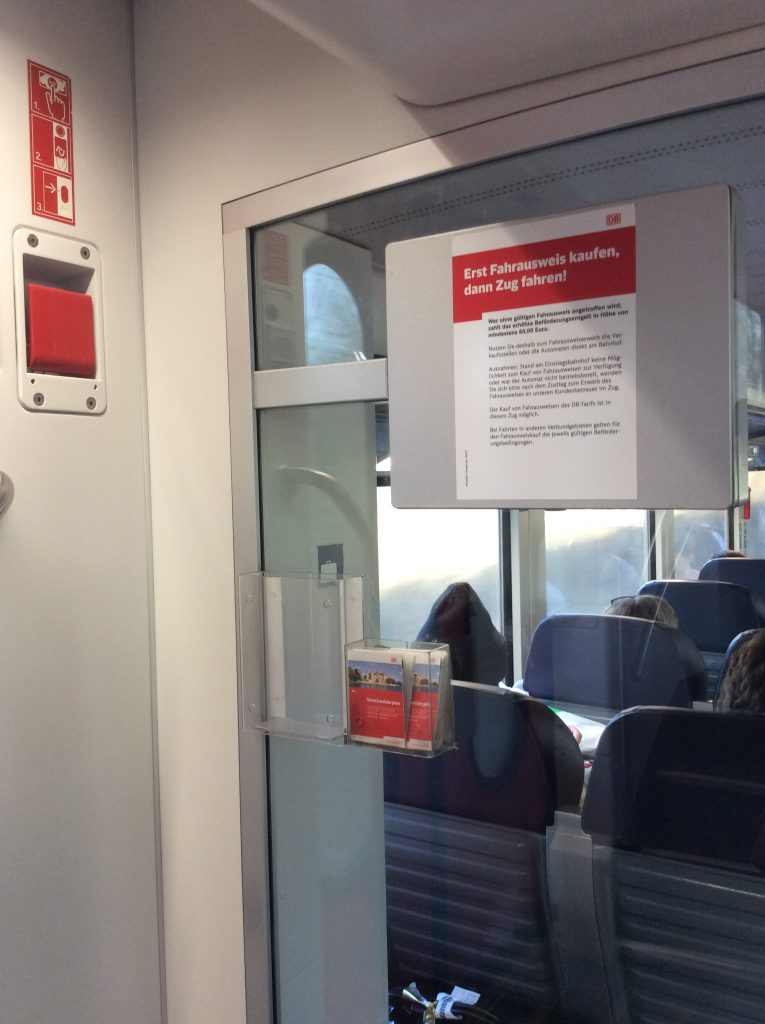 Maps and schedules are available near the doors: train travel in Germany