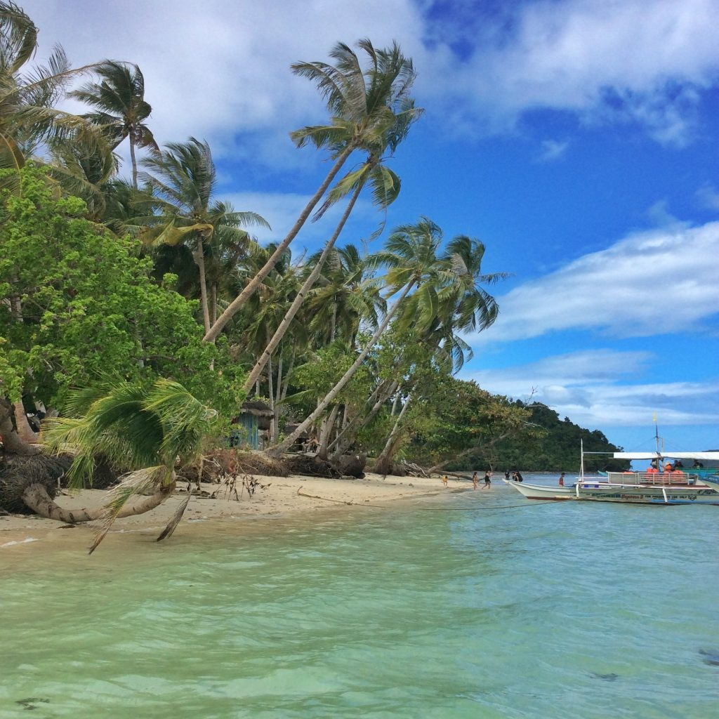 Island hopping from Port Barton, Palawan- gorgeous beaches attract many visitors to the Philippines