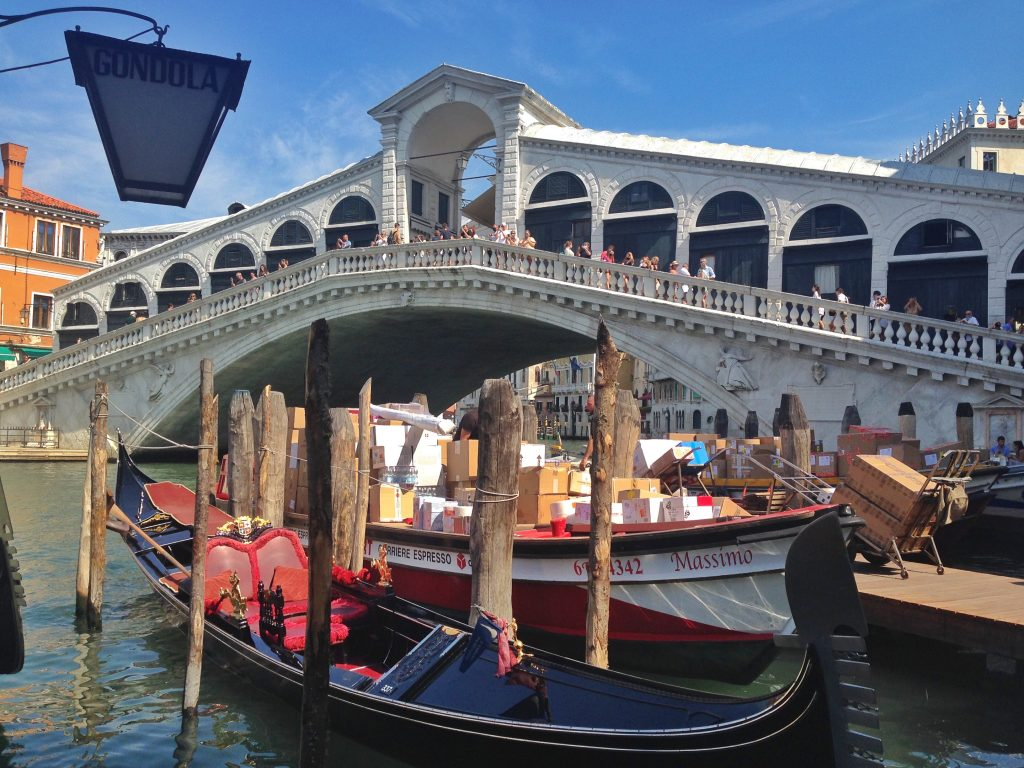 gondolas at the Rialto Bridge in Venice, Italy